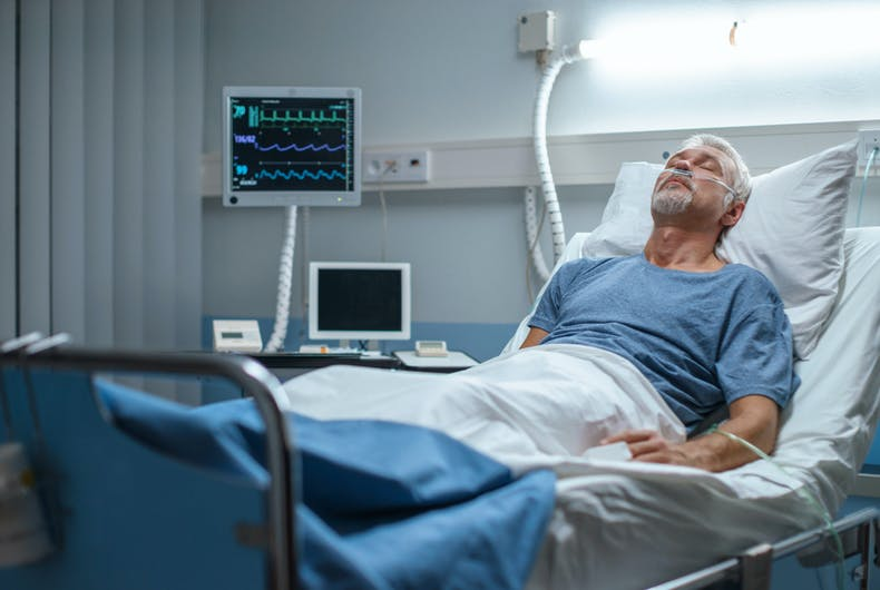 An old white man in a hospital bed. It's a stock photo.