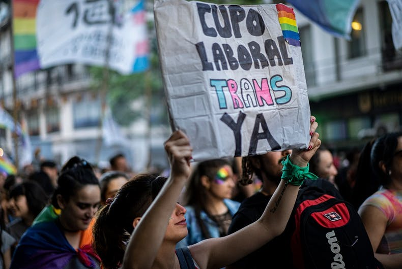 A sign in favor of a trans work quota at Buenos Aires Pride in 2019