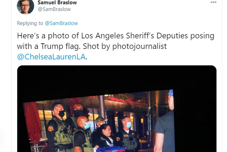 "Sheriff deputies pose with Trump flags at tiny ""Gays for Trump"" WeHo ""takeover"""