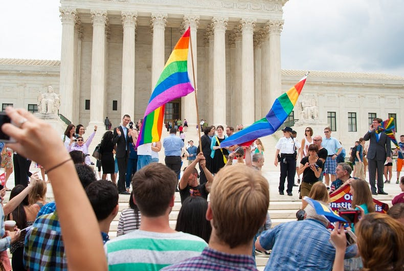 A crowd gathers at the U.S. Supreme opinion after its ruling legalizing same-sex marriage in all fifty states was delivered on June 26, 2015