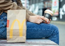 A McDonald's restaurant partners with a 'G-A-Y' club to provide meals so they can reopen sooner