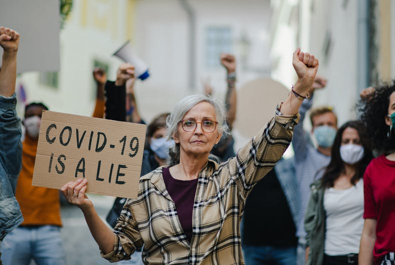 A older woman protestor holding a